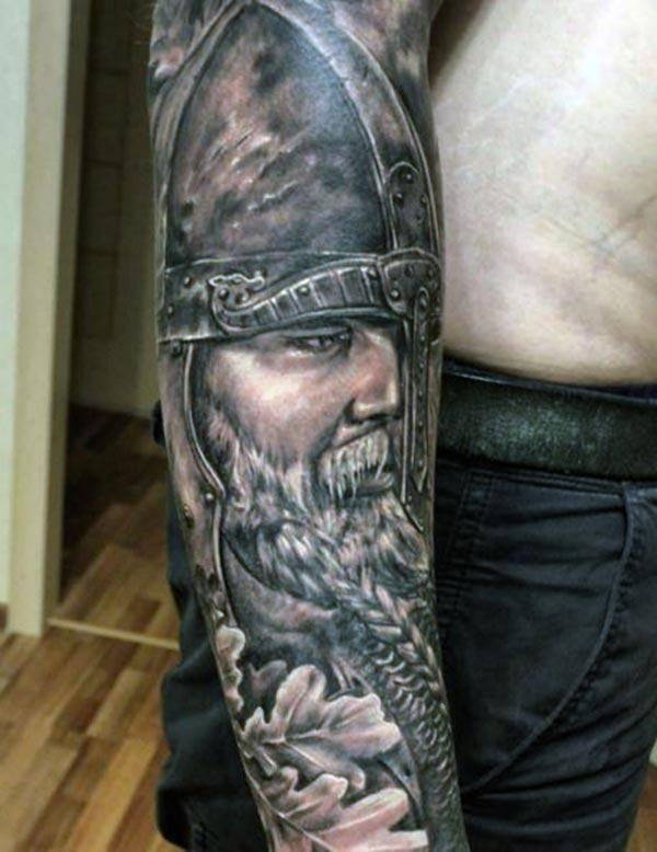 Viking tattoo on the right arm make a man look cool