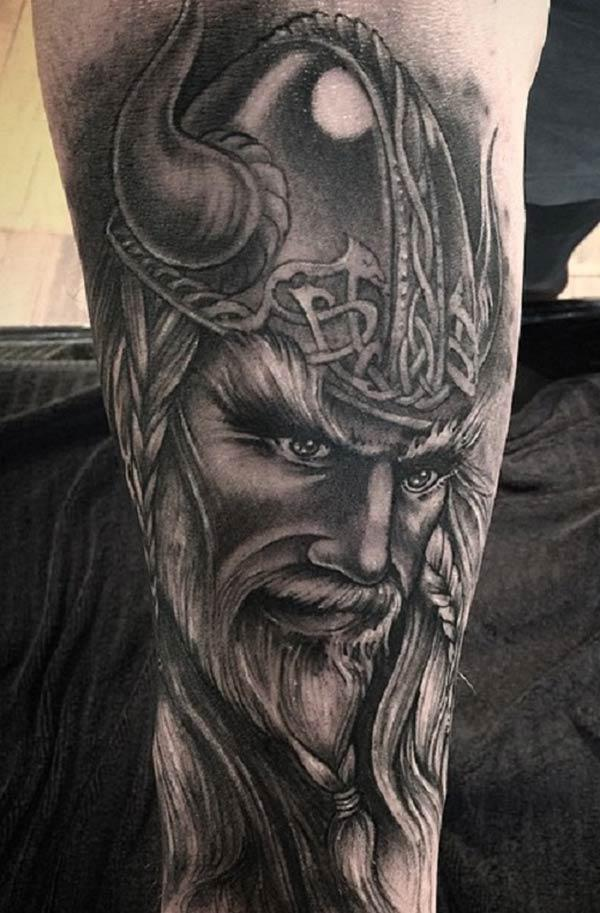 Viking tattoo on the lower arm brings the dapper look in a man