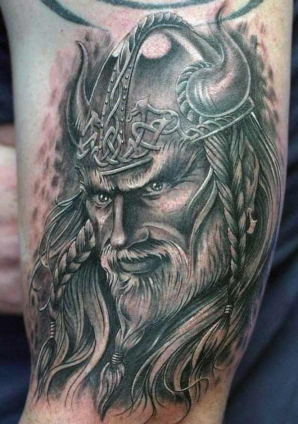 Viking tattoo for men with dark ink design makes a man look cute
