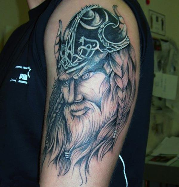 Viking tattoo with a black and brown design ink makes a man look attractive