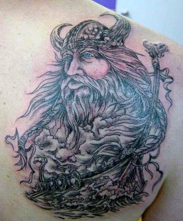 The Viking tattoo on the upper chest with a brown ink design make a man look comely
