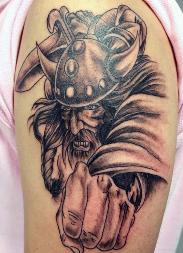 Viking tattoo with a brown ink design makes a man look ornate