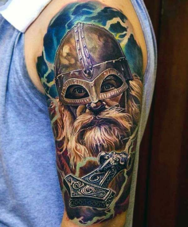 Viking tattoo with a brown ink design makes a man look stylish