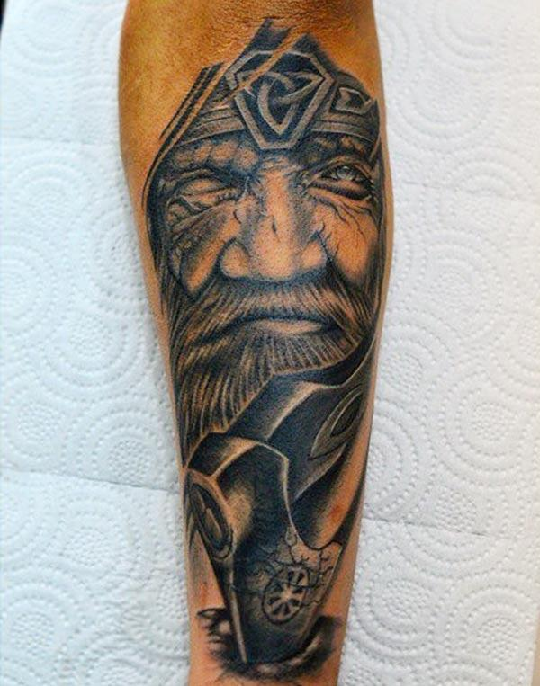 Viking tattoo on the front foot make a man look gallant