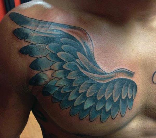 Wing Tattoo on the chest overlapping to the arm makes a man look admirable