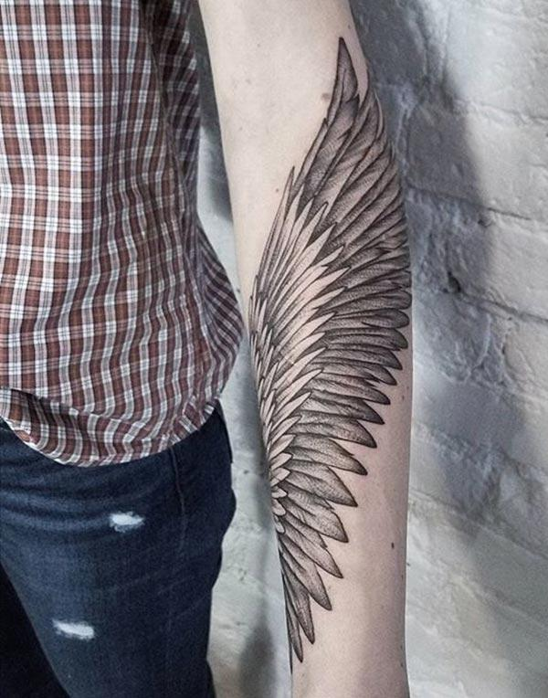 Wing Tattoo on the lower arm makes a man look cool