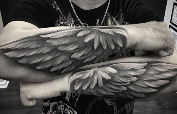 Wing tattoo with a brown ink design on the lower arms shows their foxy look
