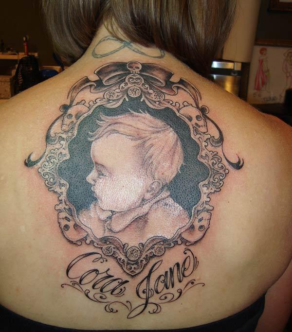 Brown ink design of the Baby tattoo on the back neck of ladies make them look attractive