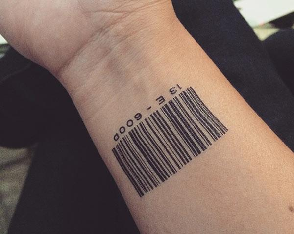 Barcode tattoo with a black ink design on the lower arm shows their foxy look