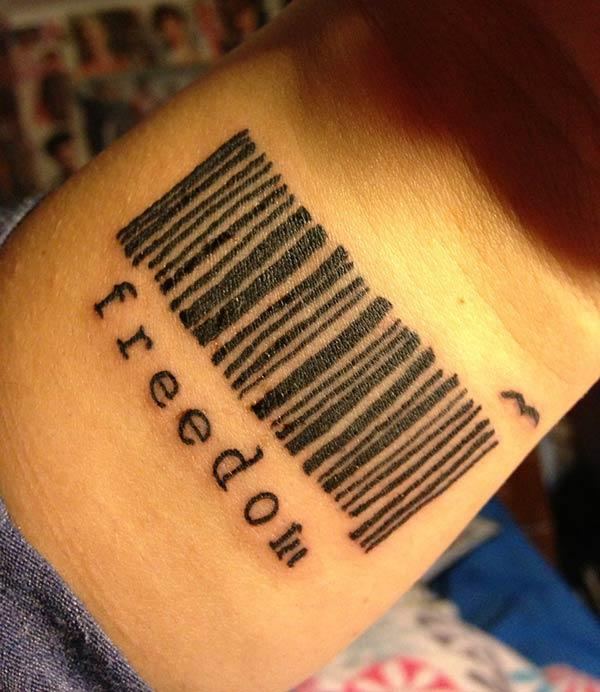 The Ink design in this Barcode tattoo matches the skin color to make a man look magnificent