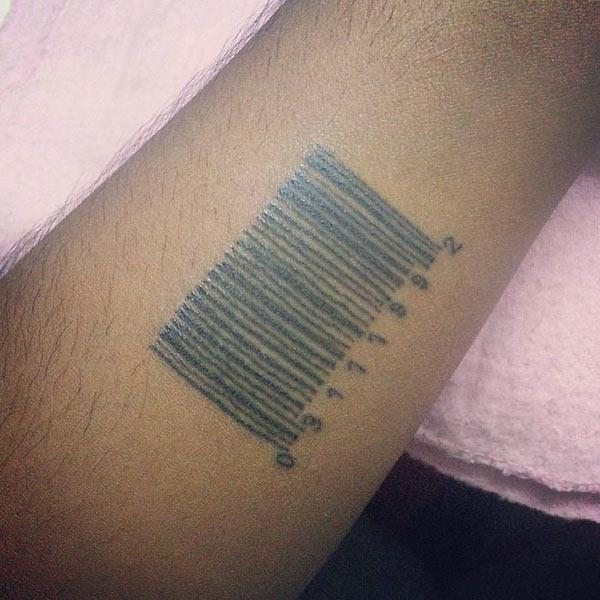 Barcode tattoo on the lower arm makes a man look gallant