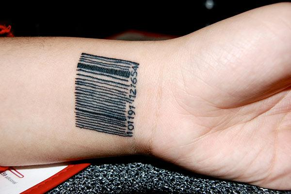 Barcode tattoo with a black ink design on the wrist shows their foxy look