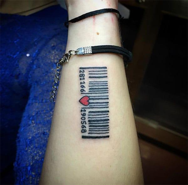 Barcode tattoo on the lower arm brings the astonishing look