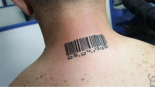 The dark design ink of the Barcode tattoo on the back neck matches the skin color give a man a dapper look