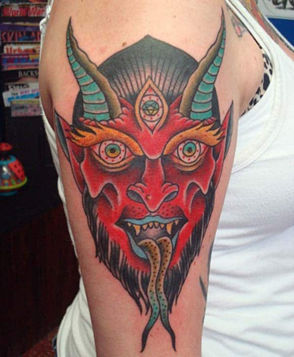 Devil Tattoo on the right shoulder brings the exquisite look
