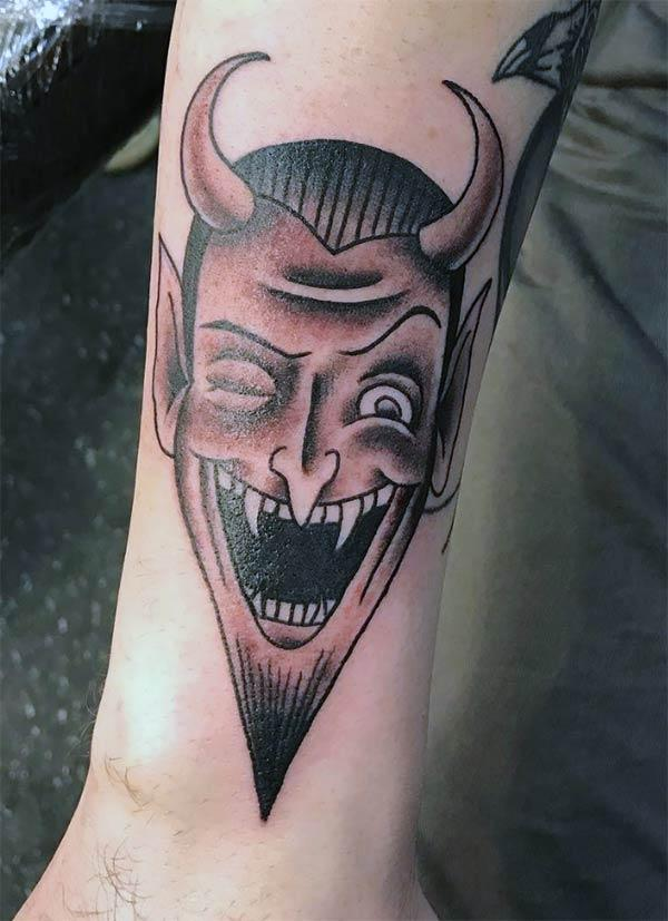 The Ink design in this Devil Tattoo matches the skin color to make a man look magnificent