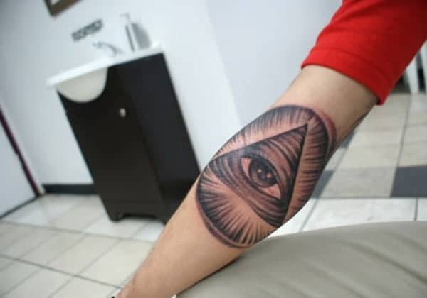 Eye of God Tattoo for men with a brown ink design makes them look marvelous