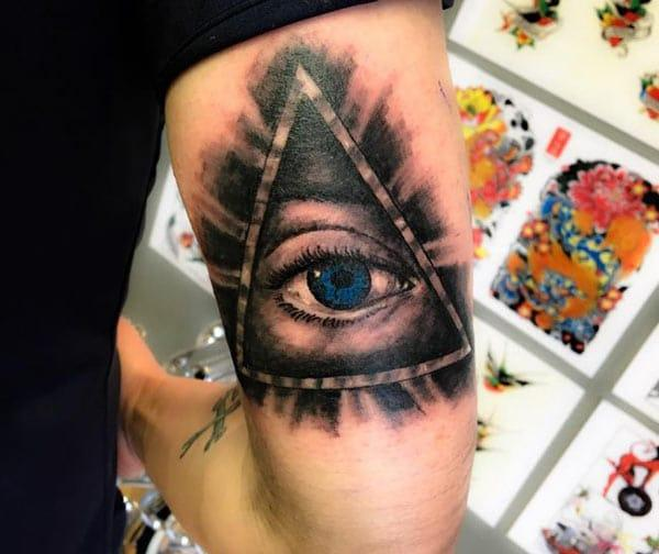 Eye of God Tattoo on the back upper arm makes a man look gallant