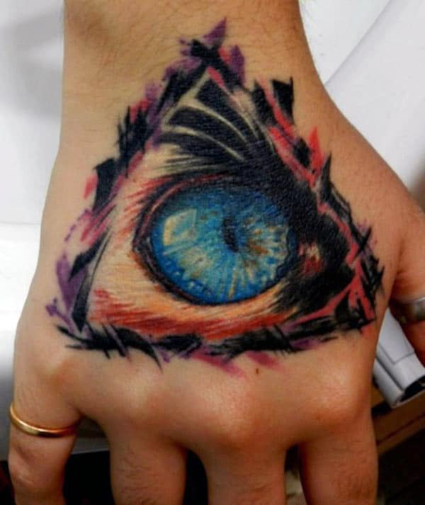 Eye of God Tattoo design idea on the hand makes a man look cool