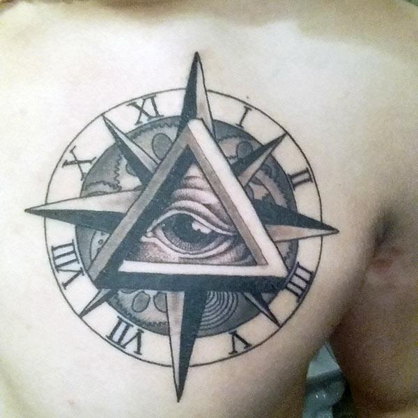 Eye of God Tattoo on the upper chest makes a man have a hunky look