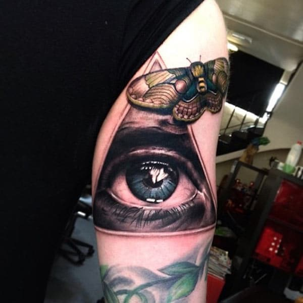 Eye of God Tattoo on the upper arm makes men appear stately