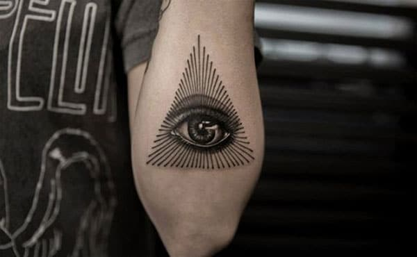 Eye of God Tattoo with a black ink design on the lower arm shows their foxy look
