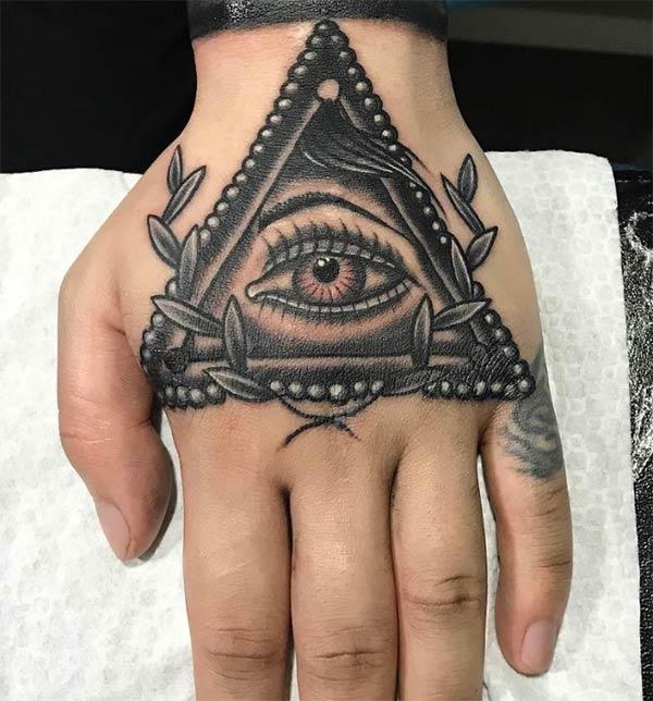 Eye of God Tattoo on the hand brings the dapper look in a man