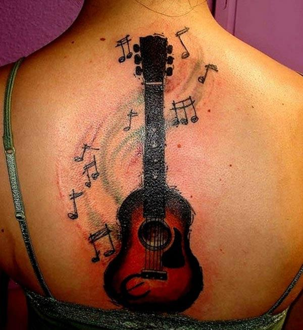 Guitar Tattoo with black ink design brings a gorgeous look