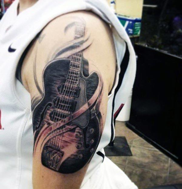 Guitar Tattoo for men makes them look spruce