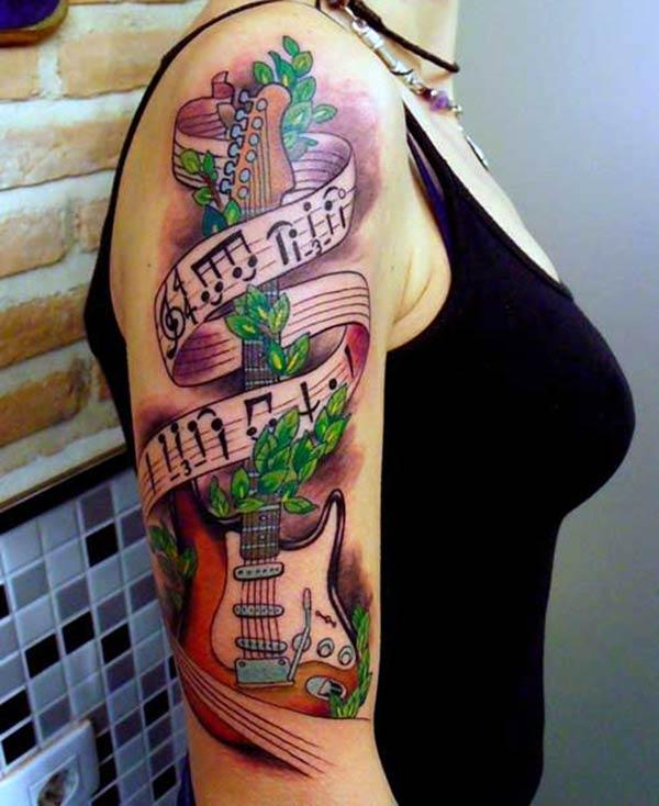 Guitar Tattoo on the shoulder makes a lady look exquisite