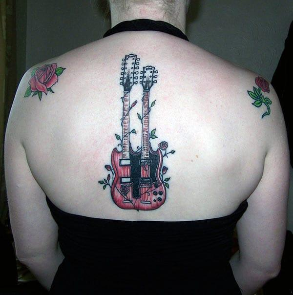 This bright Guitar Tattoo design ink to make girls look more charismatic