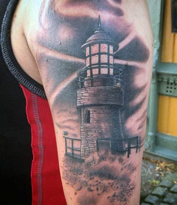 Lighthouse Tattoo on the upper arm make a man look stylish