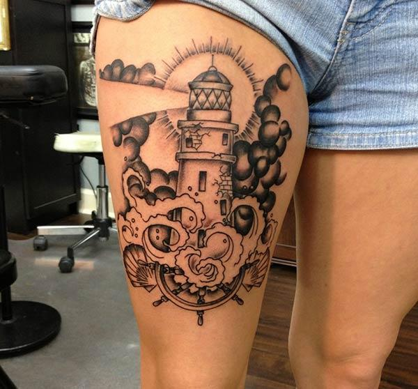 Lighthouse Tattoo on the upper thigh gives the girls an attractive look
