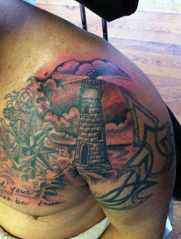 The bright ink design on the Lighthouse Tattoo on the upper chest to the shoulder make a man look majestic