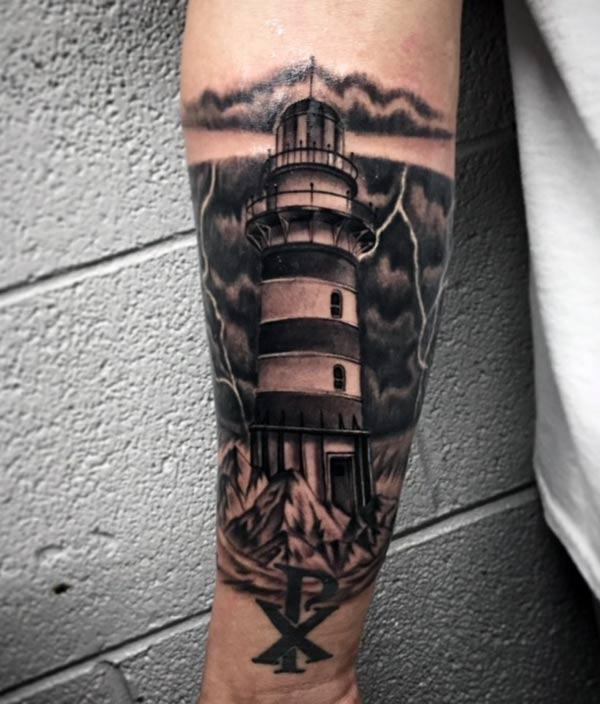 Lighthouse Tattoo on the lower arm make a man look marvelous