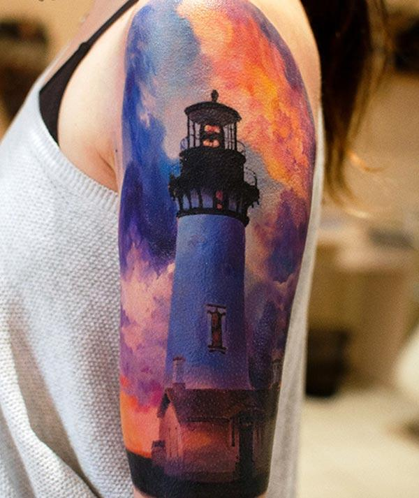 Lighthouse Tattoo on the left shoulder brings the exquisite look