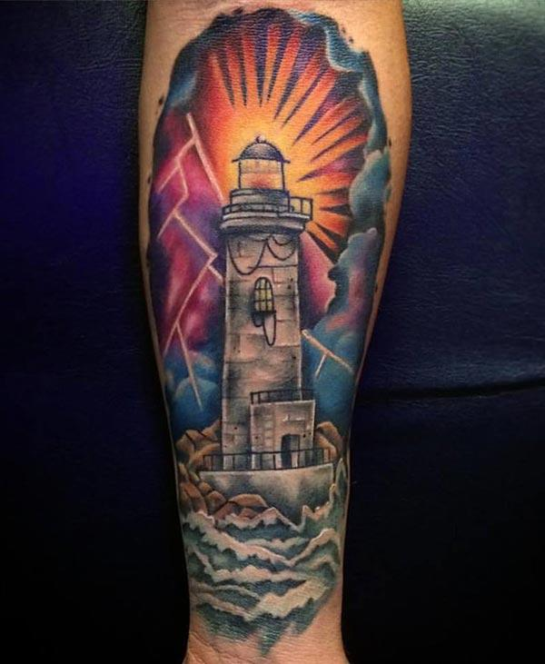 Lighthouse Tattoo with a brown ink design on the lower arm shows their foxy look