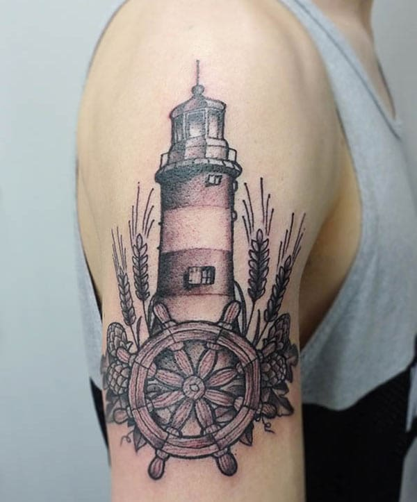 Lighthouse Tattoo with a black ink design, on the right upper arm brings the spruce appearance in men