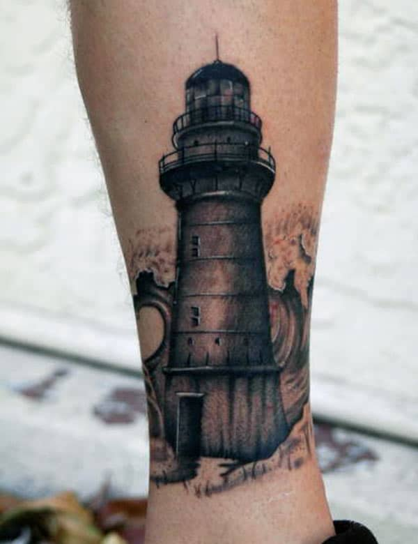 Lighthouse Tattoo on the ankle makes a man look imposing