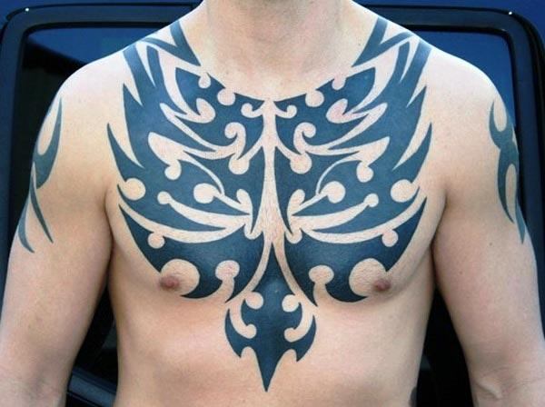 Majestic intense black tribal chest tattoo designs for Men