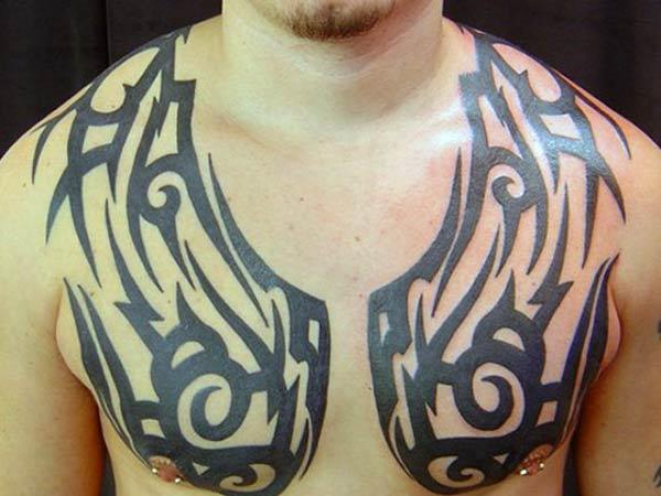 Wings like tribal chest tattoo designs for Boys