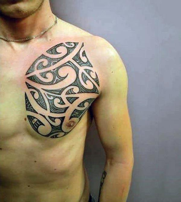 Artistic miniature tribal chest tattoo ideas for Boys