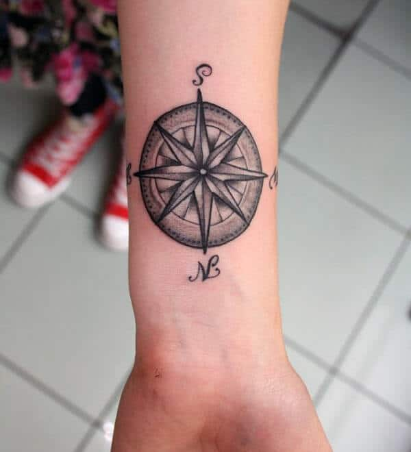 Cool black and grey compass tattoo design on wrist for Girls
