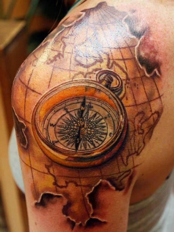 breathtaking map compass tattoo design on shoulder for women