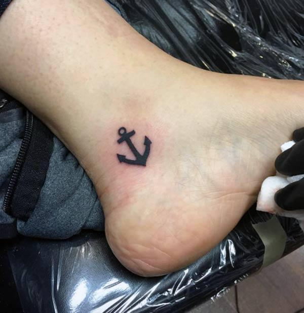 Anchor Tattoo on the foot with a black ink design brings the pretty look