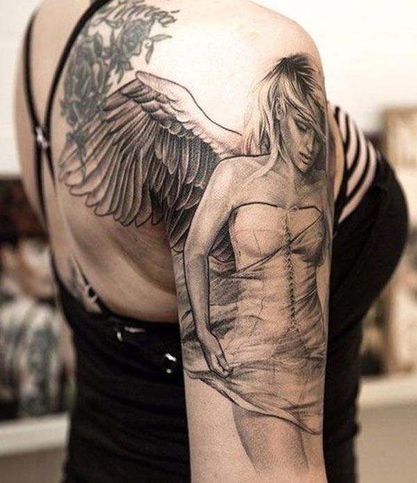 Angel tattoo on the right shoulder brings the exquisite look