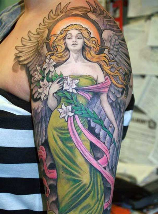 Angel tattoo on the left shoulder make a girl look stunning