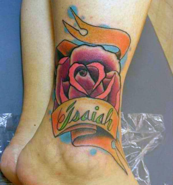 Ankle tattoo with a pink ink design make a girl look stunning