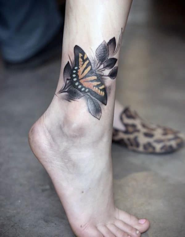 Ankle tattoo with a black ink design makes a woman look captivating