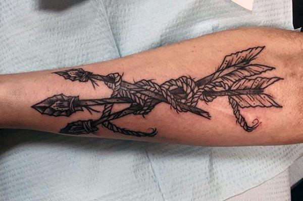 Arrow Tattoo on the lower arm brings the dapper look in a man